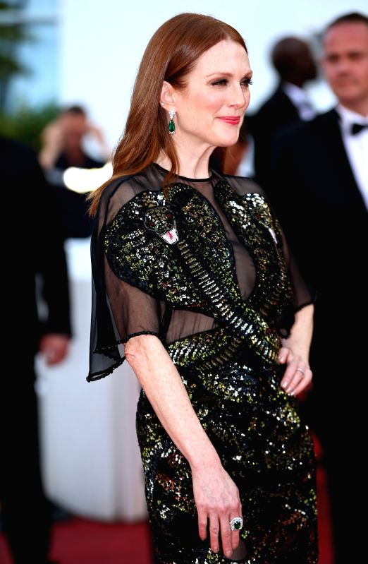 CANNES, May 11, 2011 - Actress Julianne Moore poses on the red carpet before the opening of the 69th Cannes Film Festival in Cannes, France, on May 11, 2016. The 69th Cannes Film Festival will be ... - Julianne Moore