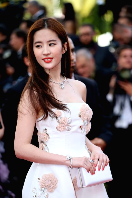 CANNES, May 11, 2011 - Chinese actress Liu Yifei poses on the red carpet before the opening of the 69th Cannes Film Festival in Cannes, France, on May 11, 2016. The 69th Cannes Film Festival will be ... - Liu Yifei