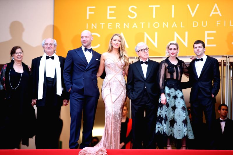 CANNES, May 11, 2011 - Director Woody Allen (3rd R) and cast members Blake Lively (C), Kristen Stewart (2nd R), Corey Stoll (3rd L) and Jesse Eisenberg (1st R) of the opening film Cafe society pose ...