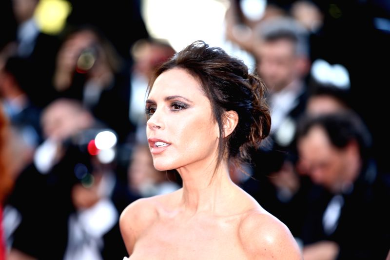 CANNES, May 11, 2011 (Xinhua) -- Fashion designer, model and singer Victoria Beckham poses on the red carpet before the opening of the 69th Cannes Film Festival in Cannes, France, on May 11, 2016. The 69th Cannes Film Festival will be held from May 1