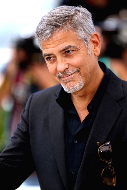 "CANNES, May 12, 2016 (Xinhua) -- Cast member George Clooney poses during a photocall for the film ""Money Monster"" during the 69th Cannes Film Festival in Cannes, France, May 12, 2016. (Xinhua/Jin Yu/IANS)"