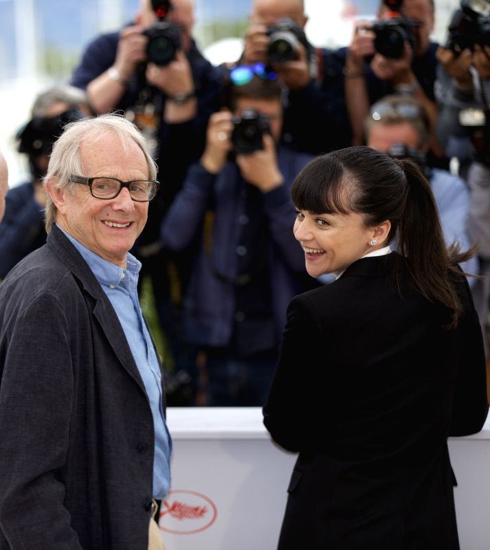 "CANNES, May 13, 2016 - Director Ken Loach (L) poses with cast member Hayley Squires during a photocall for the film ""I, Daniel Blake"" in competition at the 69th Cannes Film Festival in ..."