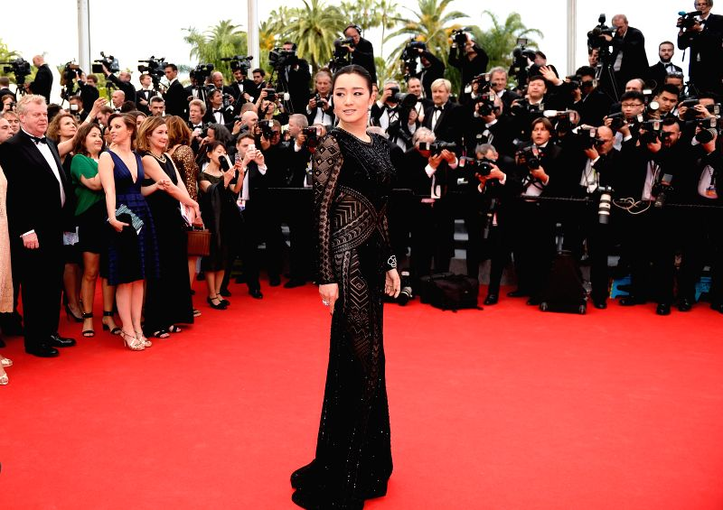 Chinese actress Gong Li arrives on the red carpet for the opening ceremony of the 67th Cannes Film Festival in Cannes, France, May 14, 2013. The festival runs from ... - Gong L