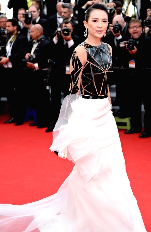 Chinese actress Zhang Ziyi arrives on the red carpet for the opening ceremony of the 67th Cannes Film Festival in Cannes, France, May 14, 2013. The festival runs from - Zhang Ziyi