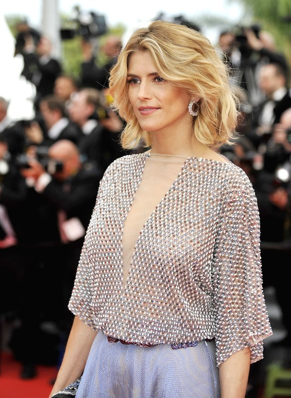 French actress Alice Taglioni arrives on the red carpet for the opening ceremony of the 67th Cannes Film Festival in Cannes, France, May 14, 2013. The festival runs .. - Alice Taglioni