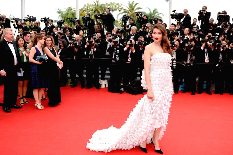 French model Laetitia Casta arrives on the red carpet for the opening ceremony of the 67th Cannes Film Festival in Cannes, France, May 14, 2013. The festival runs ... - Laetitia Casta