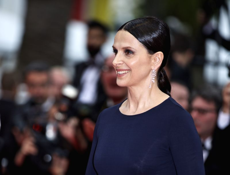 """CANNES, May 14, 2016 - Cast member Juliette Binoche poses on the red carpet as she arrives for the screening for the film """"Ma loute"""" (Slack Bay) at the 69th Cannes Film Festival in Cannes, ..."""