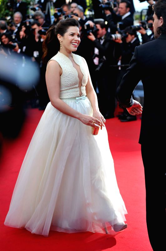 """CANNES, May 16, 2014 (Xinhua) -- American actress America Ferrera arrives for the premiere of """"How to Train Your Dragon 2"""" during the 67th Cannes Film Festival, in Cannes, France, May 15, 2014. (Photo: Xinhua/Chen Xiaowei/IANS)"""