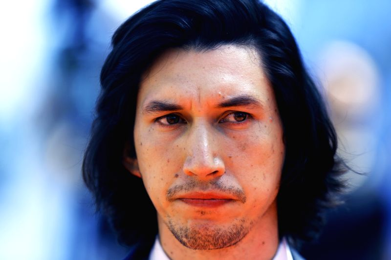 """CANNES, May 16, 2016 - Cast members Adam Driver poses on red carpet while arriving for the screening of the film """"Paterson"""" in competition at the 69th Cannes Film Festival in Cannes, ..."""