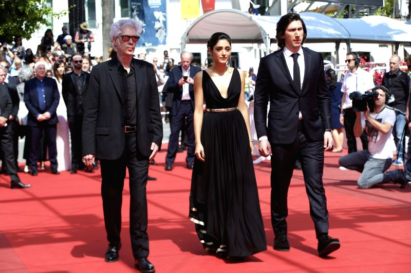 """CANNES, May 16, 2016 - Director Jim Jarmusch (L), cast members Adam Driver (R) and Golshifteh Farahani pose on red carpet while arriving for the screening of the film """"Paterson"""" in ..."""