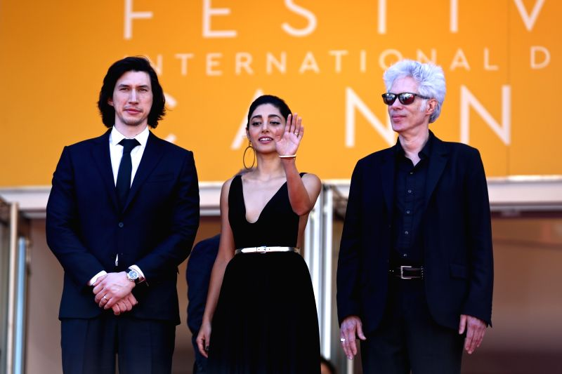 """CANNES, May 16, 2016 - Director Jim Jarmusch (R), cast members Adam Driver (L) and Golshifteh Farahani pose on red carpet while arriving for the screening of the film """"Paterson"""" in ..."""