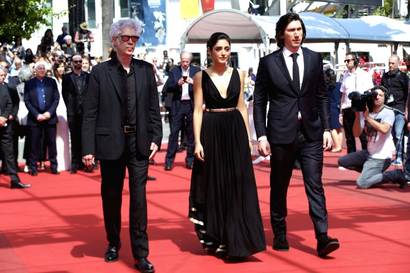 """CANNES, May 16, 2016 - Director Jim Jarmush (L), cast members Adam Driver (R) and Golshifteh Farahani pose on red carpet while arriving for the screening of the film """"Paterson"""" in ..."""