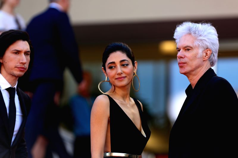 """CANNES, May 16, 2016 - Director Jim Jarmush (R), cast members Adam Driver (L) and Golshifteh Farahani pose on red carpet while arriving for the screening of the film """"Paterson"""" in ..."""