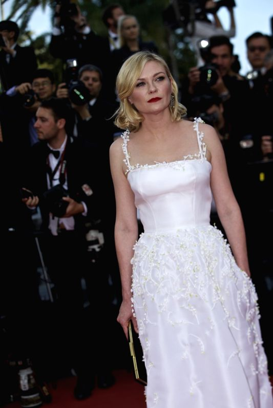 "CANNES, May 16, 2016 - Jury member actress Kirsten Dunst poses on the red carpet as she arrives for the screening of film ""Loving"" in competition at the 69th Cannes Film Festival in Cannes, ... - Kirsten Dunst"