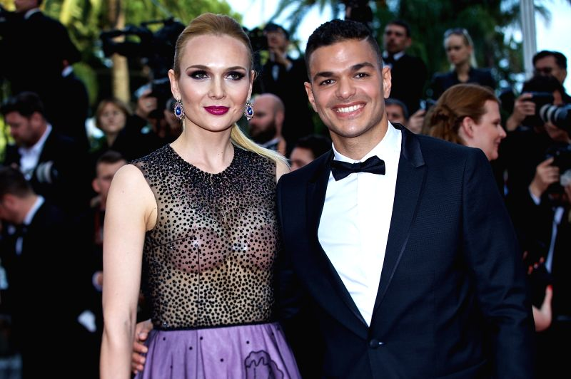 "CANNES, May 16, 2016 - Soccer player Hatem Ben Arfa (R) and a guest pose on the red carpet as they arrive for the screening of film ""Loving"" in competition at the 69th Cannes Film Festival ..."