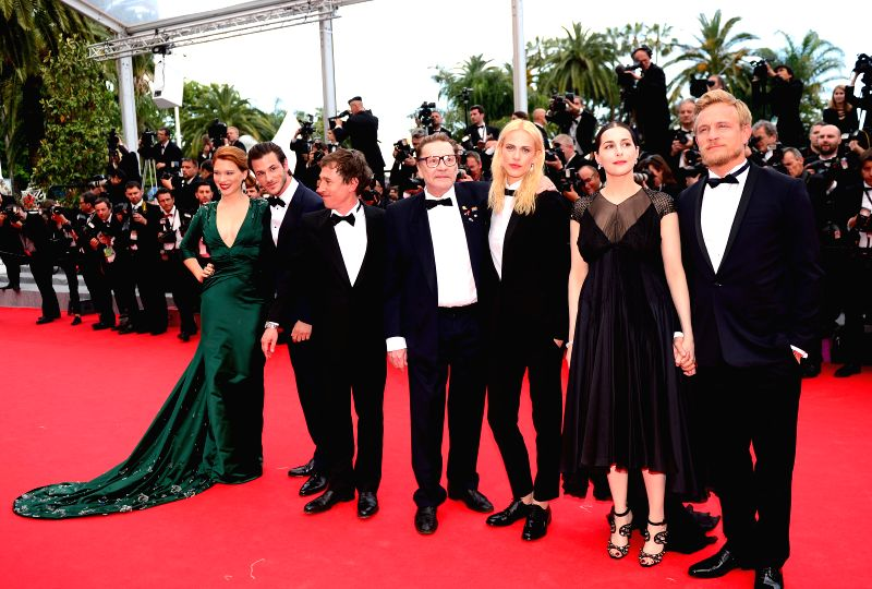 Cast members and guests arrive for the screening of the film Saint Laurent at the 67th Cannes Film Festival in Cannes, France, May 17, 2014.