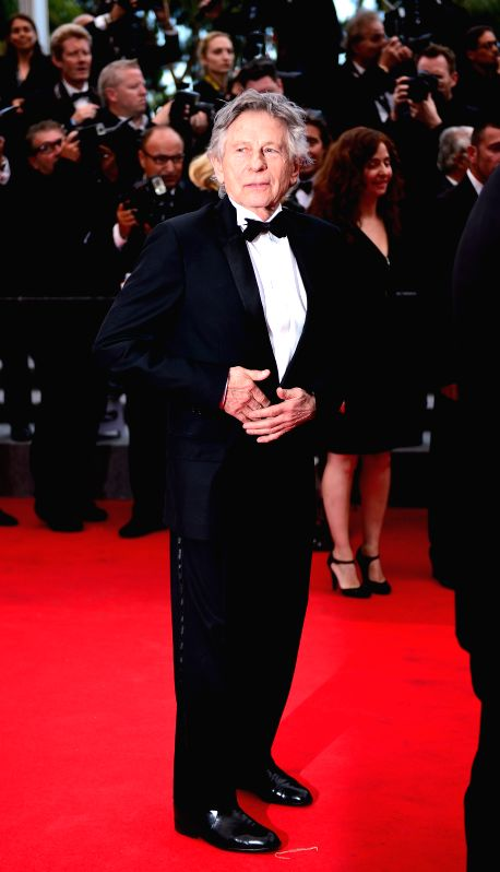 Franco-Polish director Roman Polanski arrives for the screening of the film Saint Laurent at the 67th Cannes Film Festival in Cannes, France, May 17, 2014.