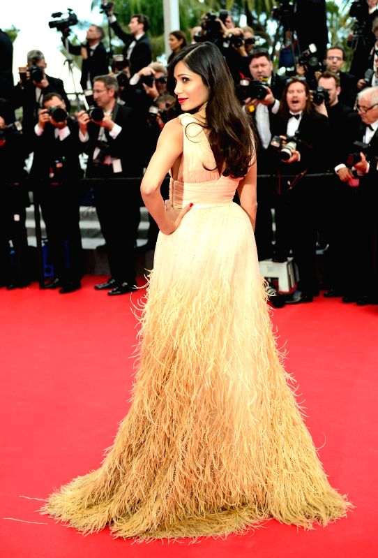 Indian actress Freida Pinto arrives for the screening of the film Saint Laurent at the 67th Cannes Film Festival in Cannes, France, May 17, 2014. - Freida Pinto