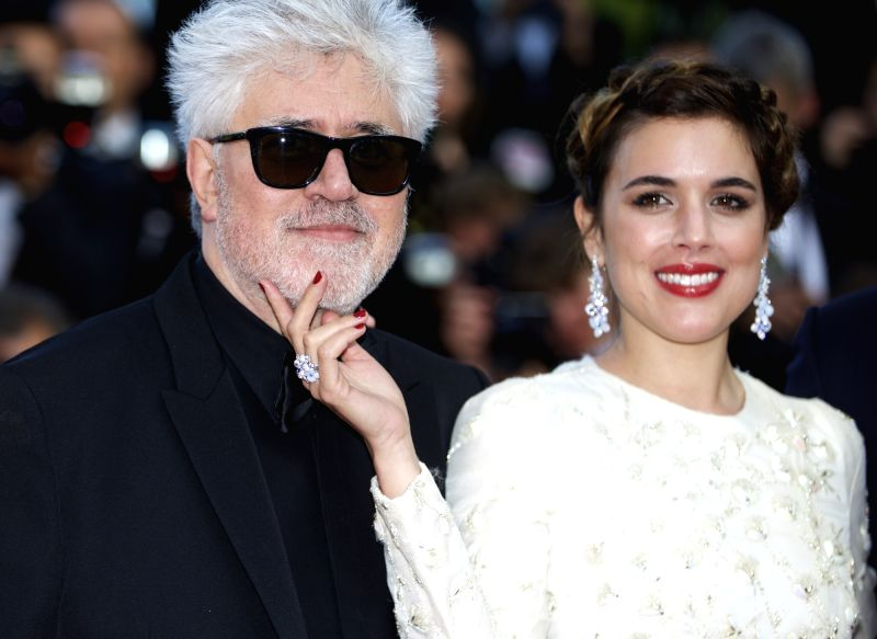 "CANNES, May 17, 2016 - Director Pedro Almodovar (L) and cast member Adriana Ugarte pose on red carpet as they arrive for the screening of the film ""Julieta"" in competition at the 69th ..."