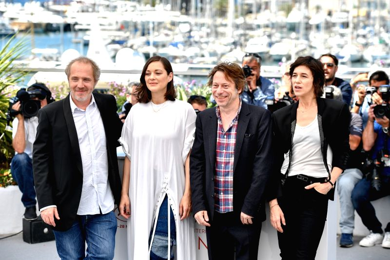 """CANNES, May 17, 2017 - Actress Marion Cotillard of the film """"Ismael's Ghosts"""" poses for a photocall before the opening of the 70th Cannes Film Festival in Cannes, France, on May 17, 2017. ... - Marion Cotillard"""