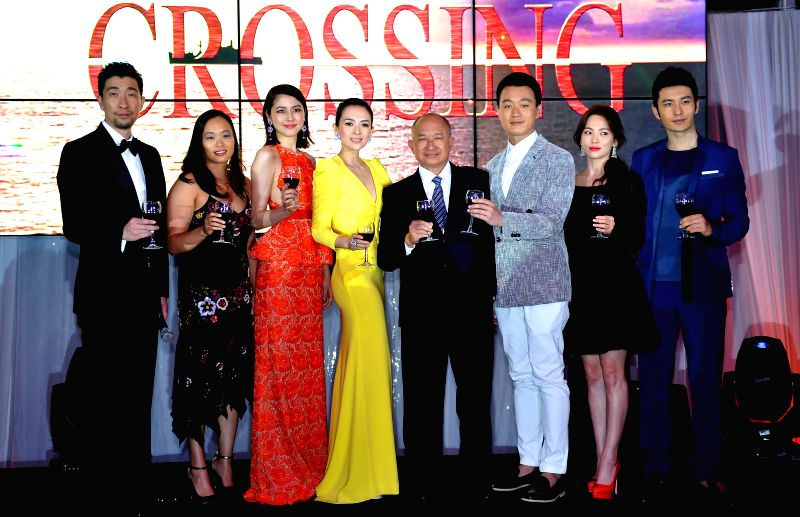 "Cast members attend the promotion of film ""The Crossing"" in Cannes, south France, May 17, 2014."