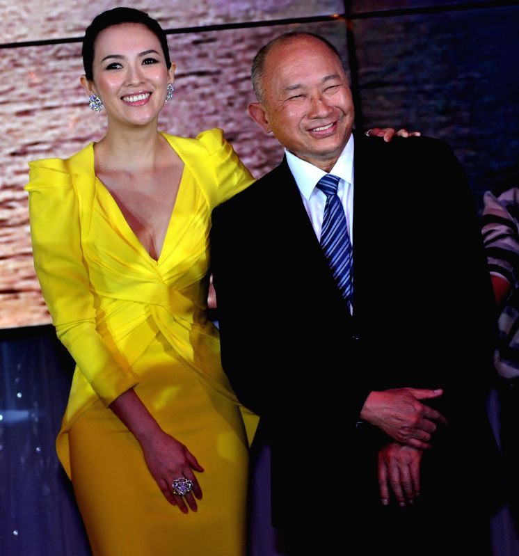 "Hollywood-based director John Woo (R) and movie star Zhang Ziyi attend the promotion of Woo's film ""The Crossing"" in Cannes, south France, May 17, 2014. ..."