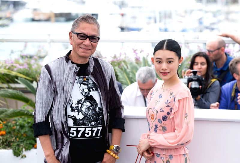 """CANNES, May 18, 2017 - Actress Hana Sugisaki (R) and director Takashi Miike pose for a photocall of the film """"Mugen no junin"""" during the 70th Cannes Film Festival in Cannes, France, on May ... - Hana Sugisaki"""