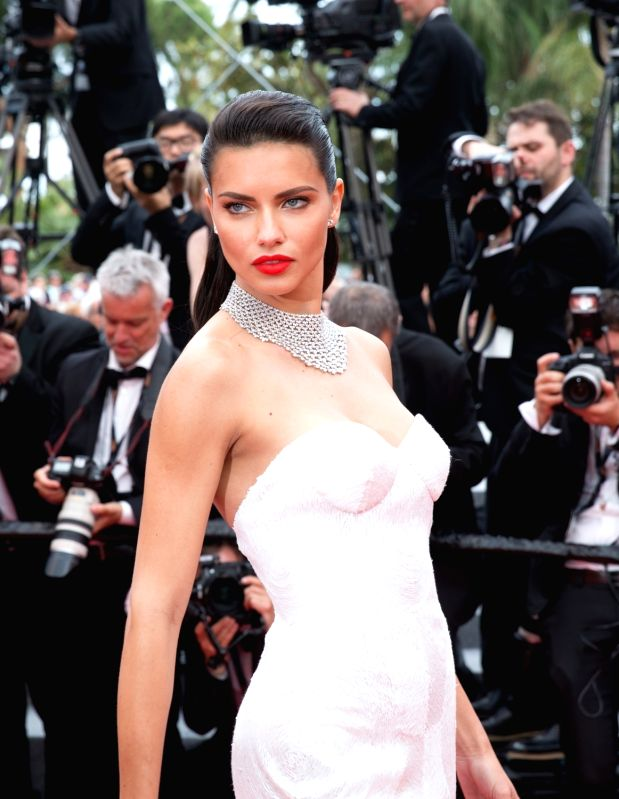 """CANNES, May 18, 2017 - Brazilian model Adriana Lima poses on the red carpet for the screening of the film """"Loveless"""" in competition at the 70th Cannes International Film Festival in Cannes, ... - Adriana Lima"""