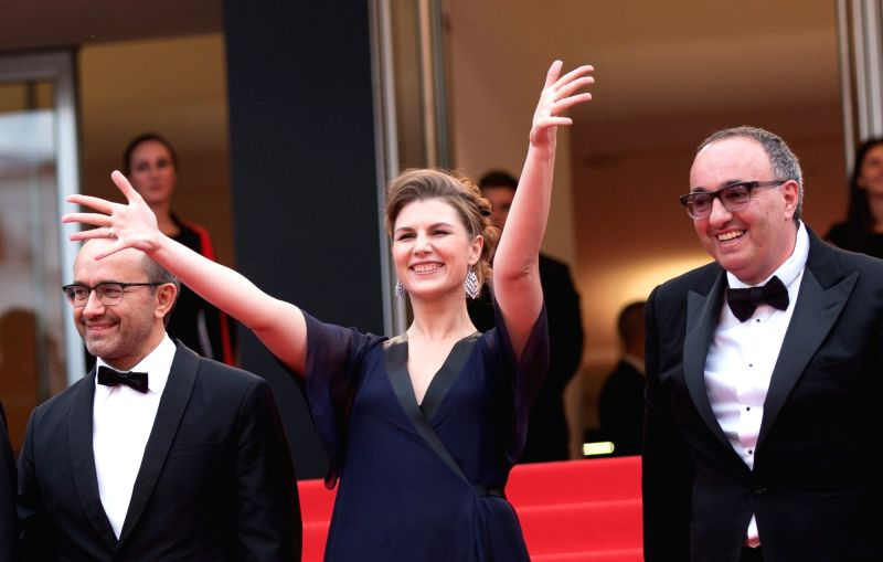 CANNES, May 18, 2017 - (From L to R) Russian director Andrey Zvyagintsev, Russian actress Maryana Spivak and Ukrainian producer Alexander Rodnyansky pose on the red carpet for the screening of the ... - Andrey Zvyagintsev