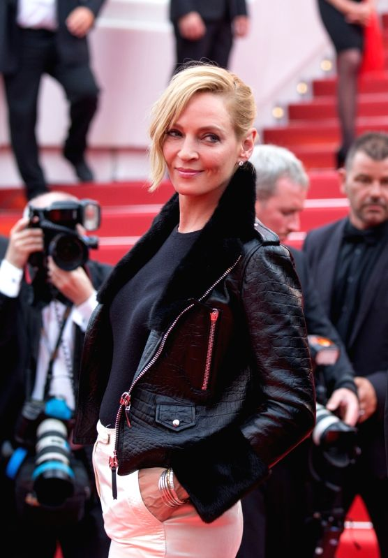 """CANNES, May 18, 2017 - U.S. actress and Jury President of Film selection """"Un Certain Regard"""" Uma Thurman poses on the red carpet for the screening of the film """"Loveless"""" in ..."""