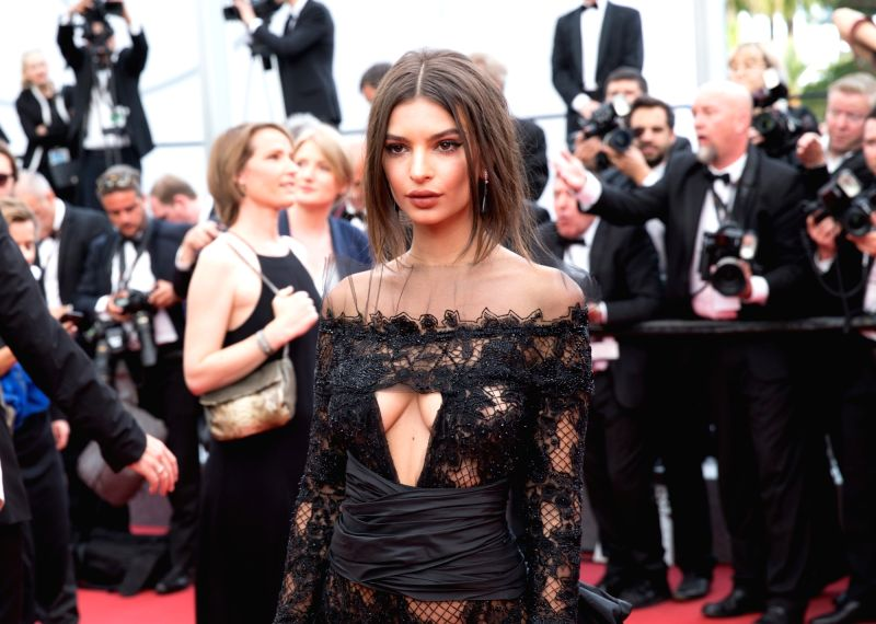 """CANNES, May 18, 2017 - U.S. actress and model Emily Ratajkowski poses on the red carpet for the screening of the film """"Loveless"""" in competition at the 70th Cannes International Film ... - Emily Ratajkowski"""