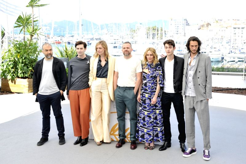 "CANNES, May 18, 2018 - Director Yann Gonzalez (C), together with other cast members of the film ""Knife+Heart""  pose during a photocall of the 71st Cannes International Film Festival in ..."