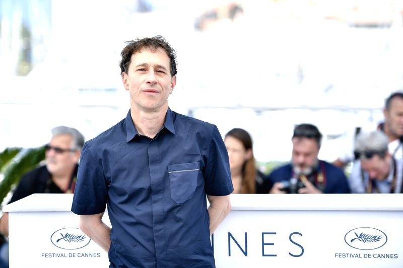 CANNES, May 18, 2018 - The president of the Short Films and Cinefondation Jury, French director Bertrand Bonello (C), poses during a photocall of the 71st Cannes International Film Festival in ... - Bertrand Bonello