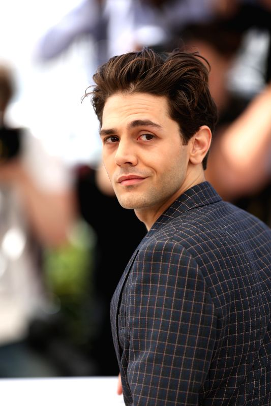 "CANNES, May 19, 2016 - Director Xavier Dolan poses during a photocall for the film ""Juste la fin du monde"" (It's Only the End of the World) in competition at the 69th Cannes Film Festival ..."