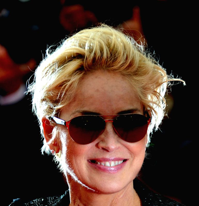 """CANNES, May 21, 2014 (Xinhua) -- Sharon Stone arrives at the red carpet for the screening of the film """"The Search"""" at the 67th Cannes Film Festival in Cannes, southern France, on May 21, 2014. (Photo: Xinhua/Chen Xiaowei/IANS)"""