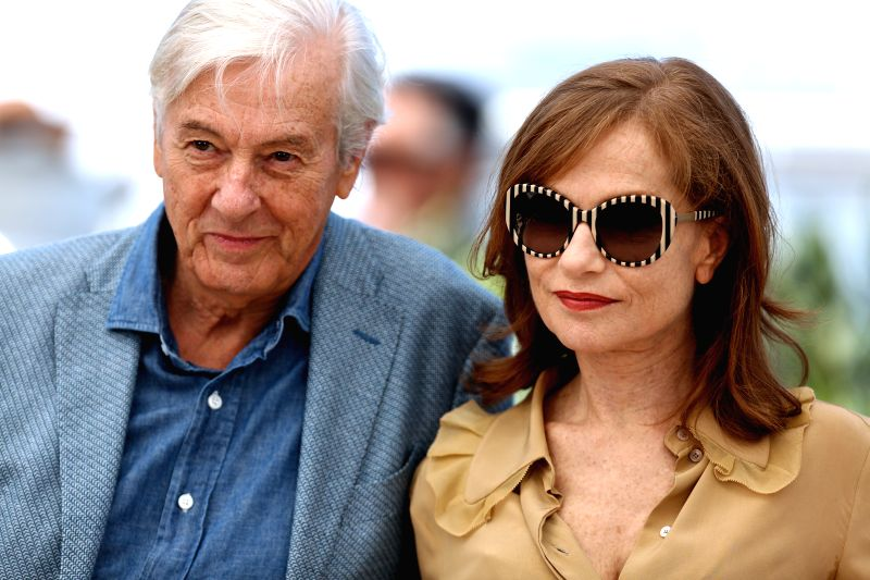 "CANNES, May 21, 2016 - French actress Isabelle Huppert(R) and Dutch director Paul Verhoeven pose on May 21, 2016 during a photocall for the film ""Elle"" at the 69th Cannes Film Festival in ... - Isabelle Huppert"
