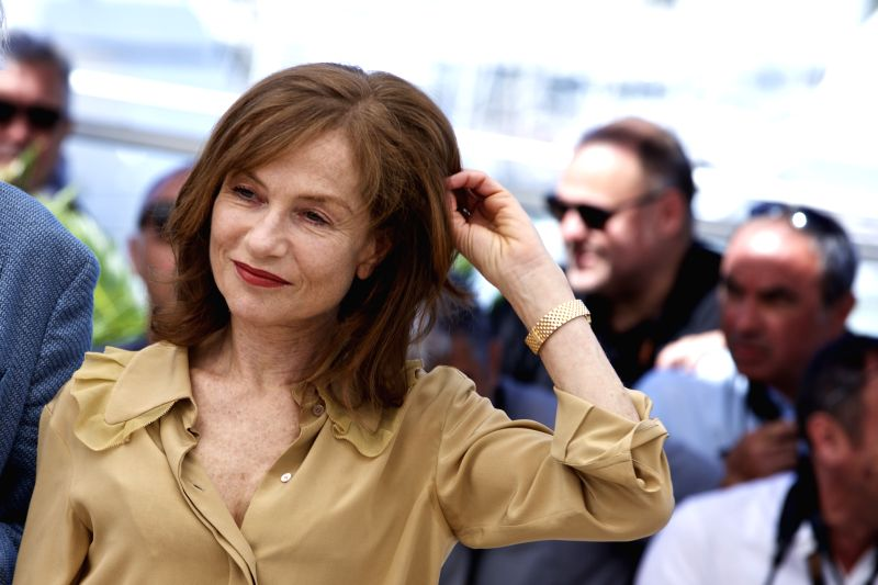 "CANNES, May 21, 2016 - French actress Isabelle Huppert poses on May 21, 2016 during a photocall for the film ""Elle"" at the 69th Cannes Film Festival in Cannes, southern France. - Isabelle Huppert"