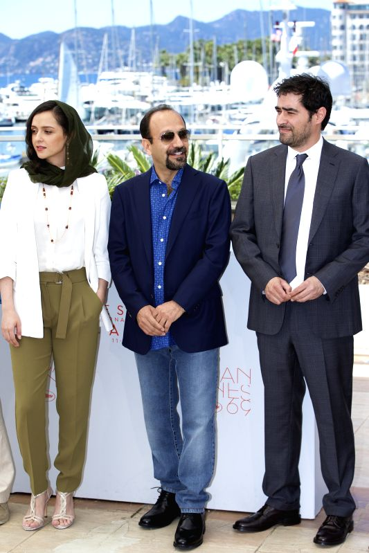 CANNES, May 21, 2016 - (From R to L) Iranian actor Shahab Hosseini, Iranian director Asghar Farhadi and Iranian actress Taraneh Alidoosti pose on May 21, 2016 during a photocall for the film ... - Shahab Hosseini