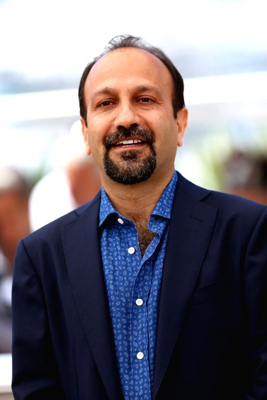 "CANNES, May 21, 2016 - Iranian director Asghar Farhadi poses on May 21, 2016 during a photocall for the film ""The Salesman (Forushande)"" at the 69th Cannes Film Festival in Cannes, southern ... - Asghar Farhadi"