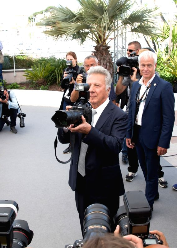 """CANNES, May 21, 2017 - Actor Dustin Hoffman (C) imitates a photographer while attending a photocall of the film """"The Meyerowitz Stories"""" during the 70th Cannes Film Festival in Cannes, ... - Dustin Hoffman"""