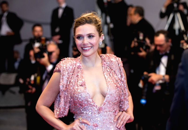 """CANNES, May 21, 2017 - American actress Elizabeth Olsen poses on the red carpet for the screening of the film """"The Square"""" in competition at the 70th Cannes International Film Festival in ... - Elizabeth Olsen"""