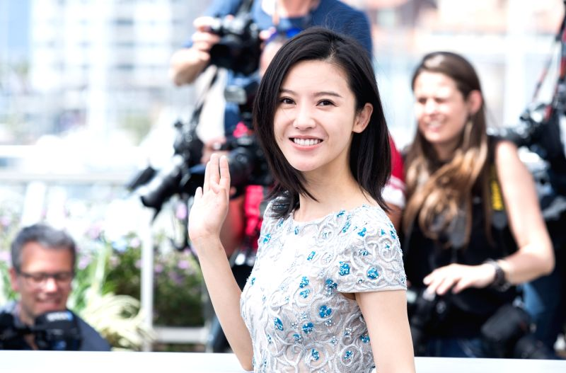"""CANNES, May 21, 2017 - Chinese actress Yang Zishan poses for a photocall of the film """"Lu Guo Wei Lai"""" during the 70th Cannes Film Festival in Cannes, France, on May 21, 2017. - Yang Zishan"""