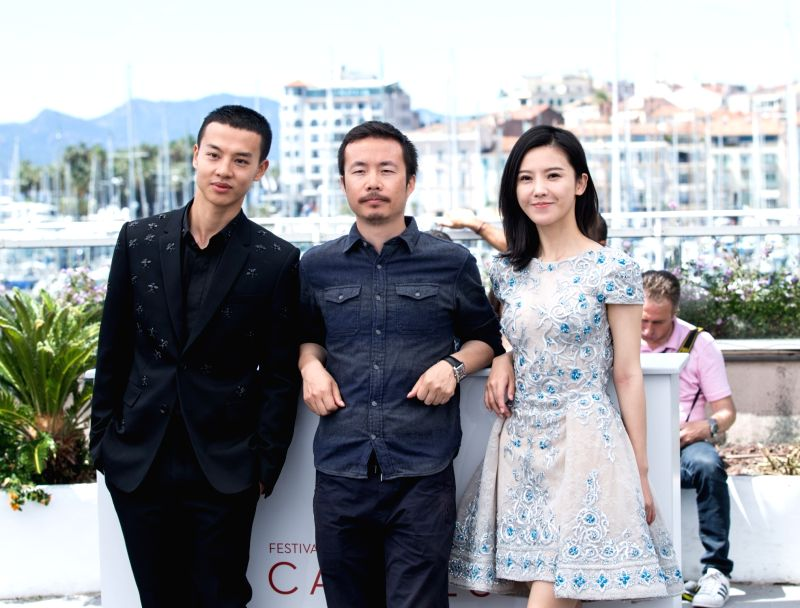 """CANNES, May 21, 2017 - Chinese director Li Ruijun (C), actor Yin Fang (L) and actress Yang Zishan pose for a photocall of the film """"Lu Guo Wei Lai"""" during the 70th Cannes Film Festival in ... - L"""