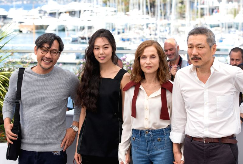 "CANNES, May 21, 2017 - Director Hong SangSoo, actresses Isabelle Huppert and Kim Minhee and a guest (From R to L) pose for a photocall of the film ""Claire's Camera"" during the 70th Cannes ... - Isabelle Huppert and Kim Minhee"