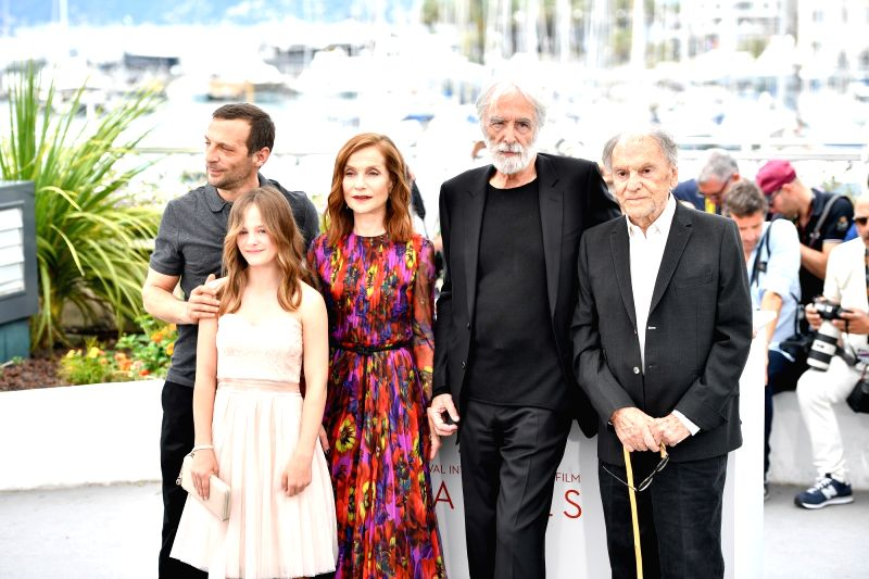 "CANNES, May 22, 2017 - Actress Isabelle Huppert (C) and cast members of the film ""Happy End"" pose for photos in Cannes, France, on May 22, 2017. The film ""Happy End"" directed by ... - Isabelle Huppert"