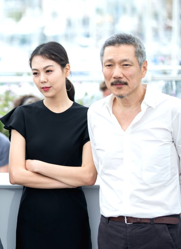 "CANNES, May 22, 2017 - Actress Kim Minhee (L) and director Hong SangSoo attend a photocall of the film ""The Day After"" during the 70th Cannes Film Festival at Palais des Festivals in ... - Kim Minhee"