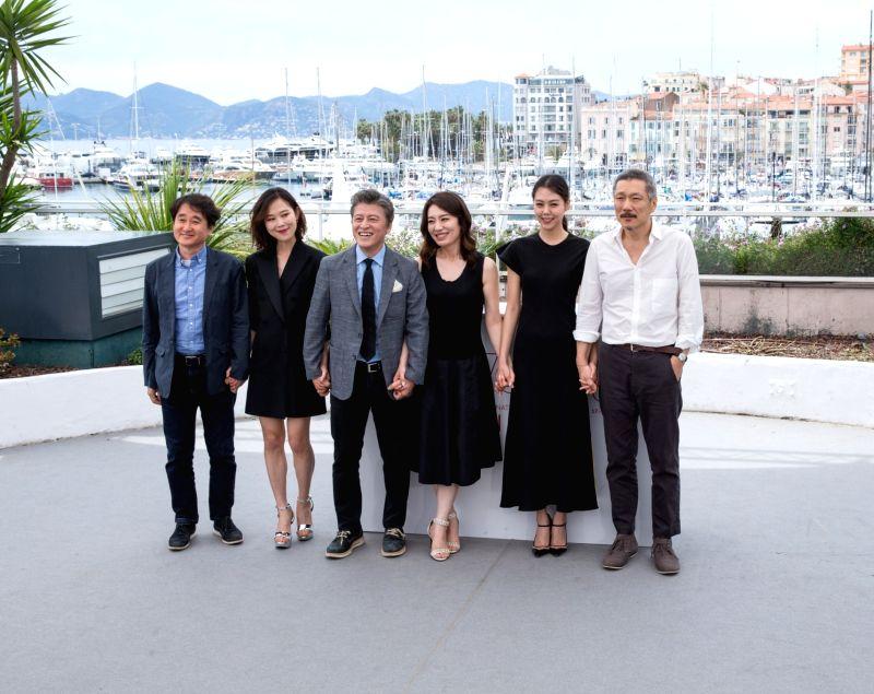 "CANNES, May 22, 2017 - Director Hong SangSoo (1st R) and cast members attend a photocall of the film ""The Day After"" during the 70th Cannes Film Festival at Palais des Festivals in Cannes, ..."