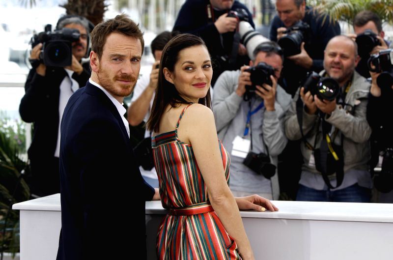 """Actress Marion Cotillard (R) and actor Michael Fassbender pose during the photocall of the film """"Macbeth"""" in competition at the 68th Cannes Film Festival in ... - Marion Cotillard"""