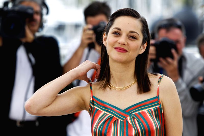 """Actress Marion Cotillard poses during the photocall of the film """"Macbeth"""" in competition at the 68th Cannes Film Festival in Cannes, France, on May 21, ... - Marion Cotillard"""