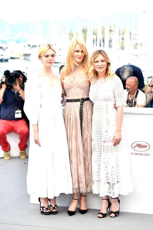 """CANNES, May 24, 2017 - Cast members Elle Fanning, Nicole Kidman and Kirsten Dunst (from L to R) of the film """"The Beguiled"""" pose for a photocall in Cannes, France on May 24, 2017. The film ... - Sofia Coppola"""